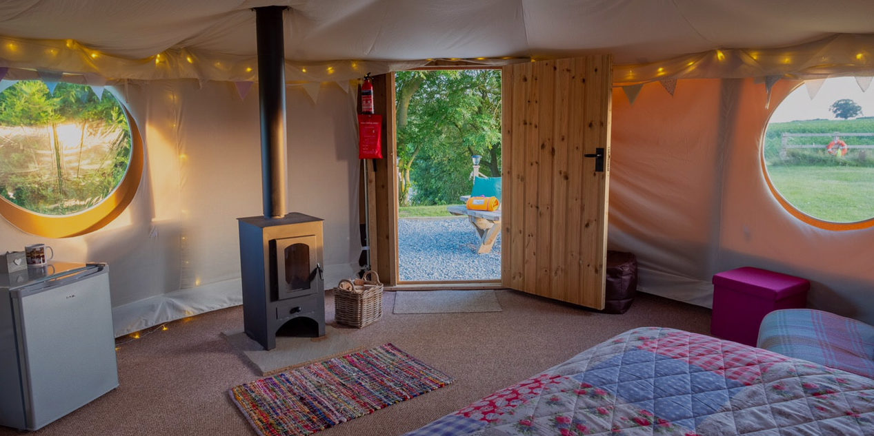 Your spacious yurt with proper locking front door and cosy log burner