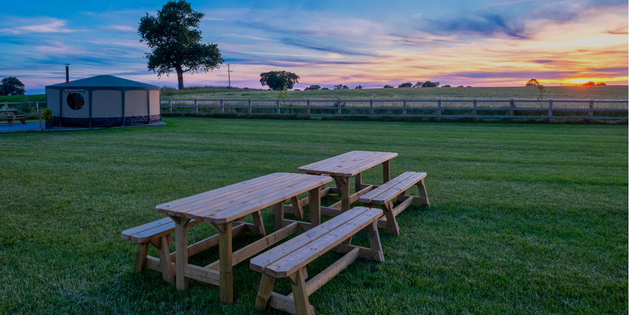 Picnic benches in the sunset
